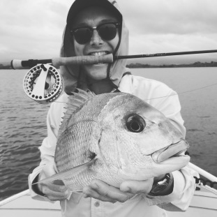 Steve with a superb salt water fly caught snapper. In shallow water these fight like demons.