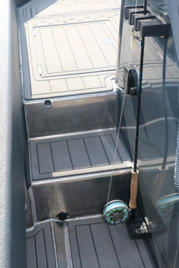 Vertical fly rod storage for quick draws when the time arises